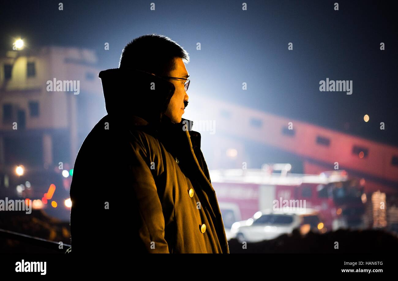 Chifeng. 4th Dec, 2016. Photo taken on Dec. 4, 2016 shows a rescuer at the site of a coal mine accident at Baoma - Stock Image