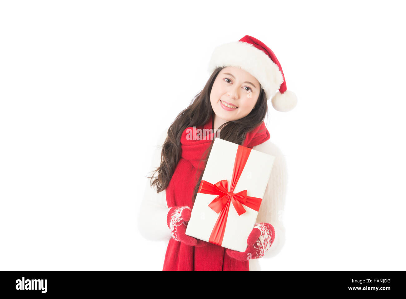 306f1a9f71b64 Christmas woman holding giving gift excited. Happy smiling woman in santa  hat giving you a present being joyful fresh and cheerful. Asian model isolat