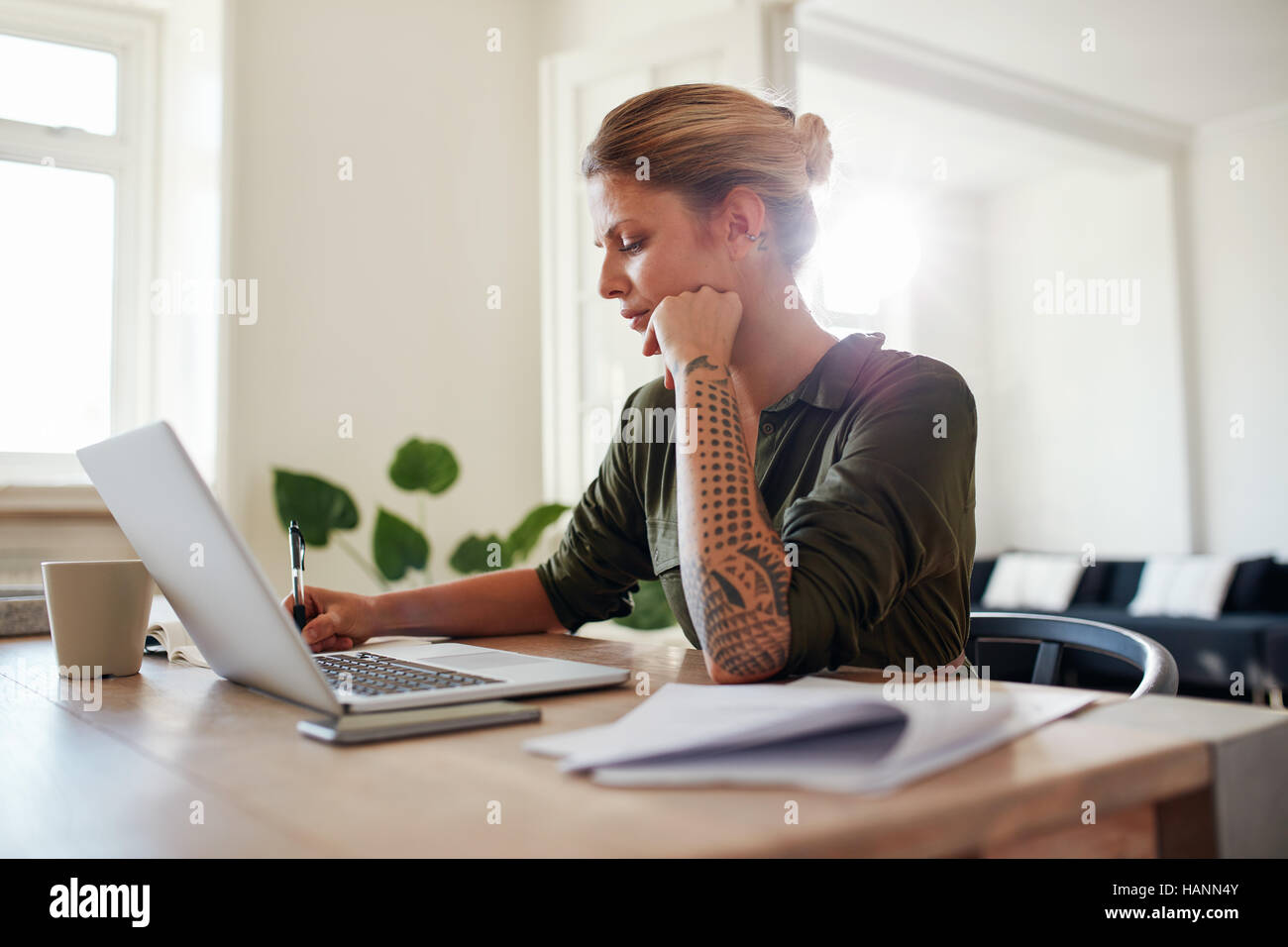 Shot of young woman working at home office. Beautiful female ...
