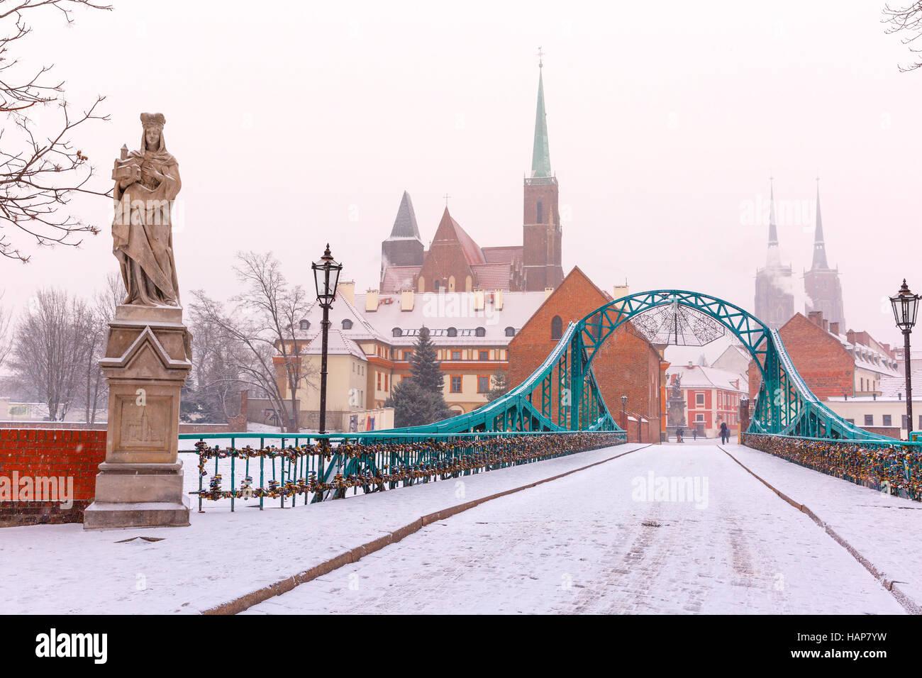 Tumski Bridge in snowy winter day, Wroclaw, Poland Stock Photo