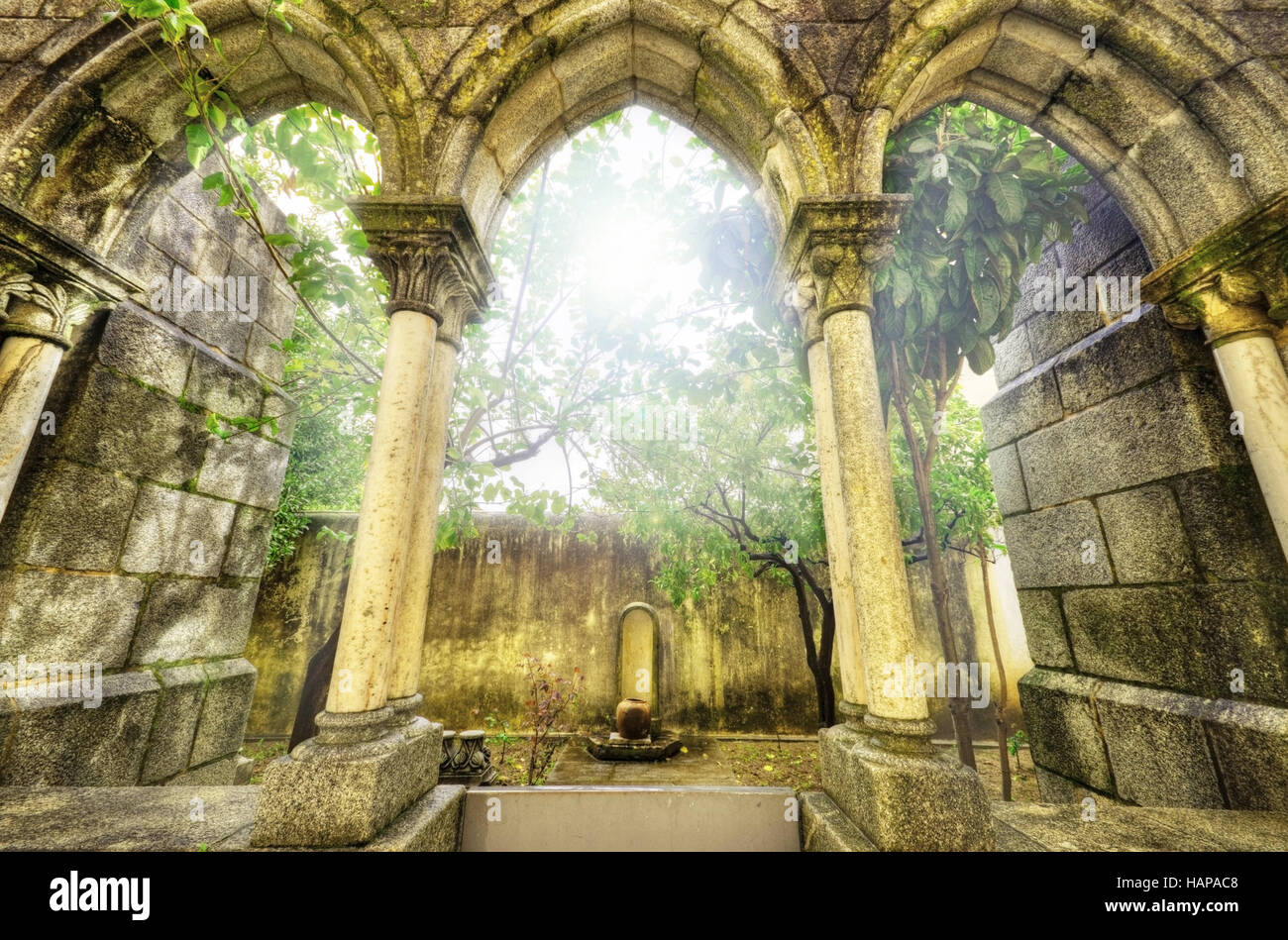 Ancient gothic arches in the myst. Fantasy landscape in Evora, Portugal. - Stock Image