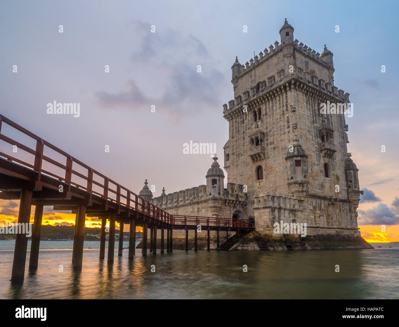 Torre de Belem on the bank of Tagus river in Lisbon, Portugal, at sunset. - Stock Image
