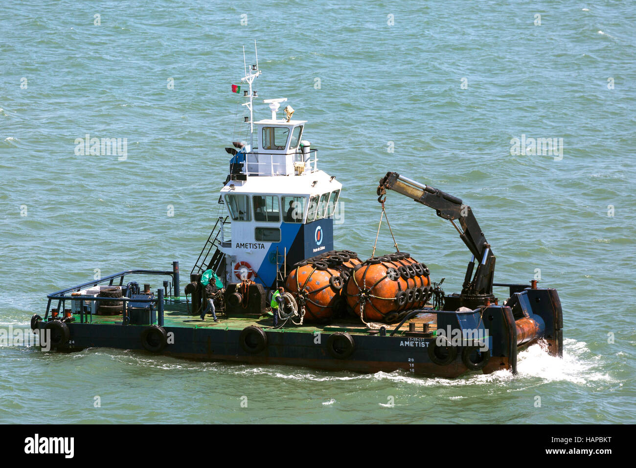 yokohamas being transported by utility vessel in Lisbon Harbour Portugal Stock Photo