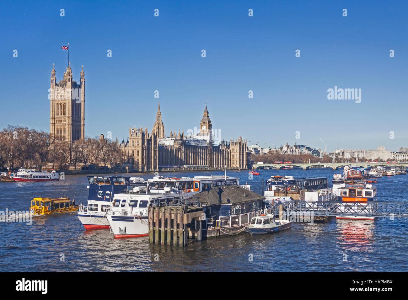London, Westminster  A flotilla of pleasure cruisers moored between Westminster and Lambeth Bridges - Stock Image
