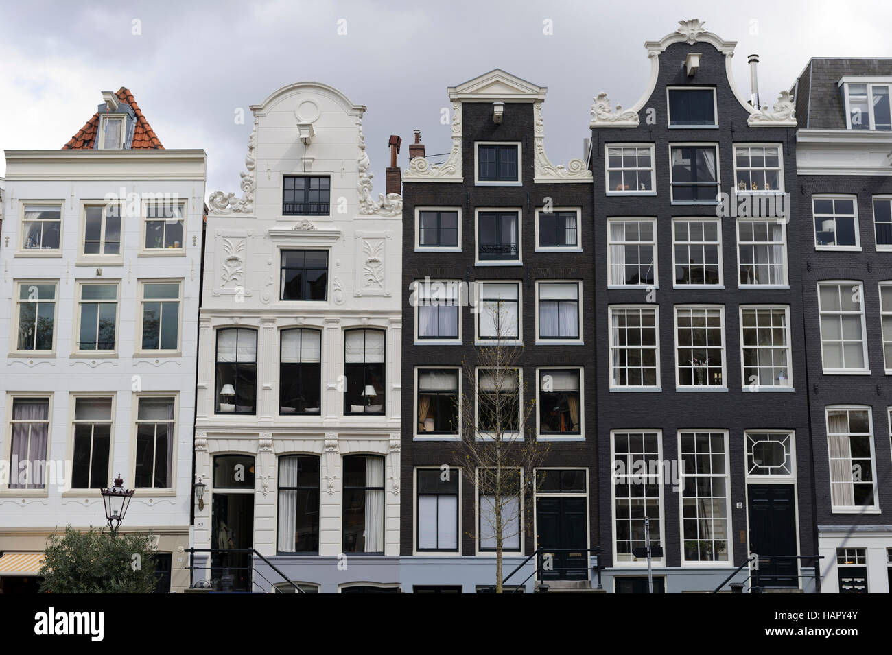 A row of traditional buildings in Amsterdam, Holland, Netherlands. - Stock Image