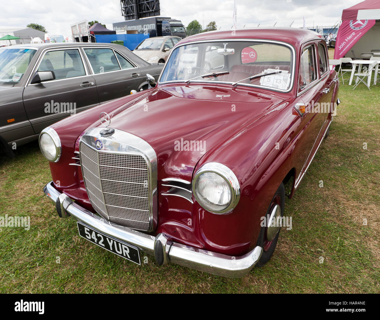 Three-quarter front view of a1961 Mercedes-Benz Ponton 190 Sedan on display at the Car Club Zone of the 2016 Silverstone - Stock Image