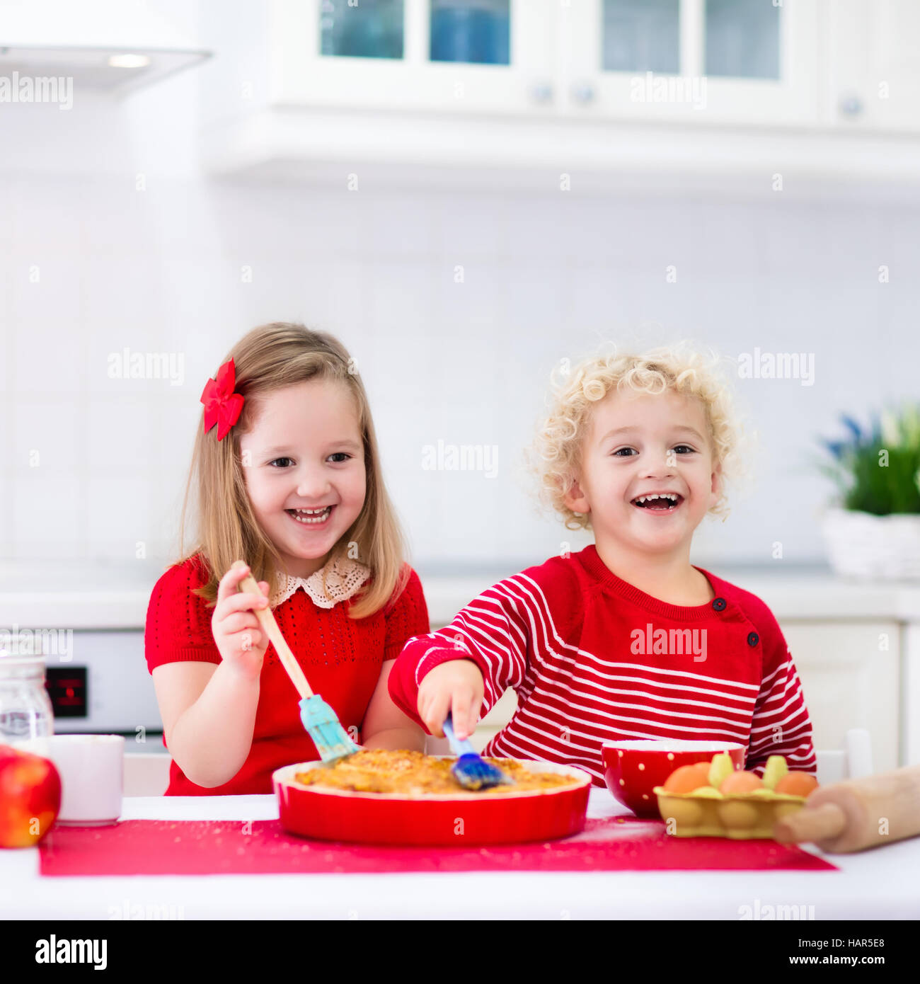 cute kids, adorable little girl and blond curly boy making dough for