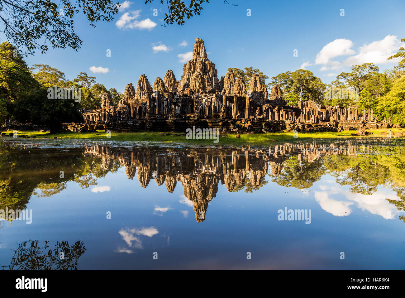 Angkor wat temple reflecting in a glassy lake - Stock Image