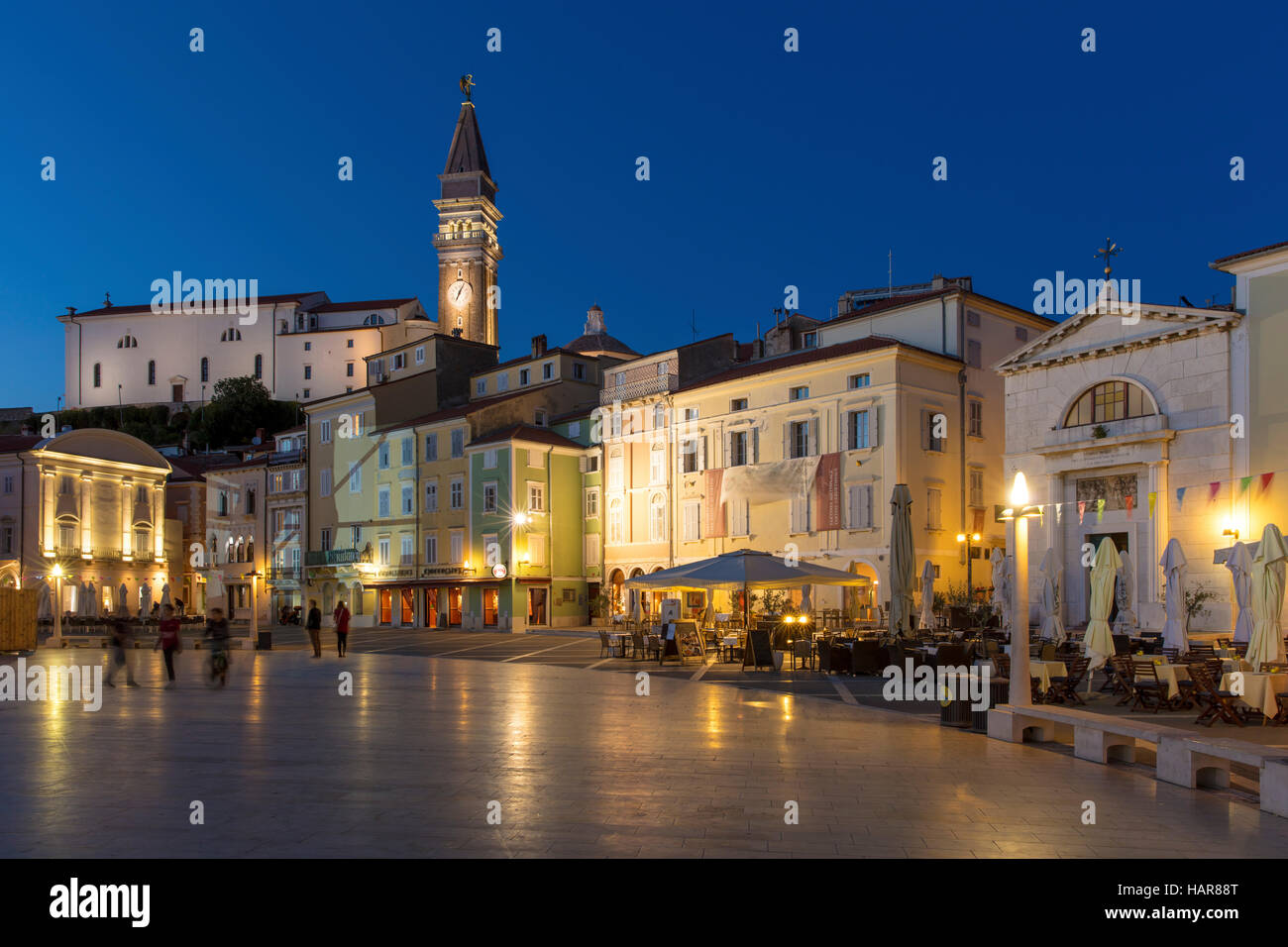 Twilight over St. George's Parish Church and town center (Tartinijev trg), Piran, Primorska, Slovenia Stock Photo