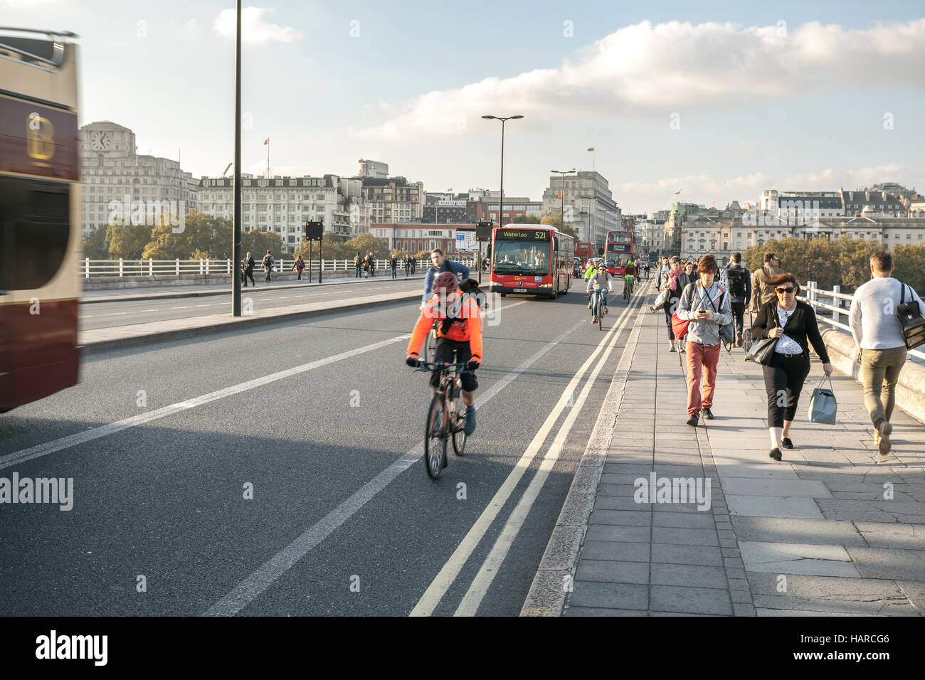 London bus, people and bicyclists crossing Waterloo bridge - Stock Image