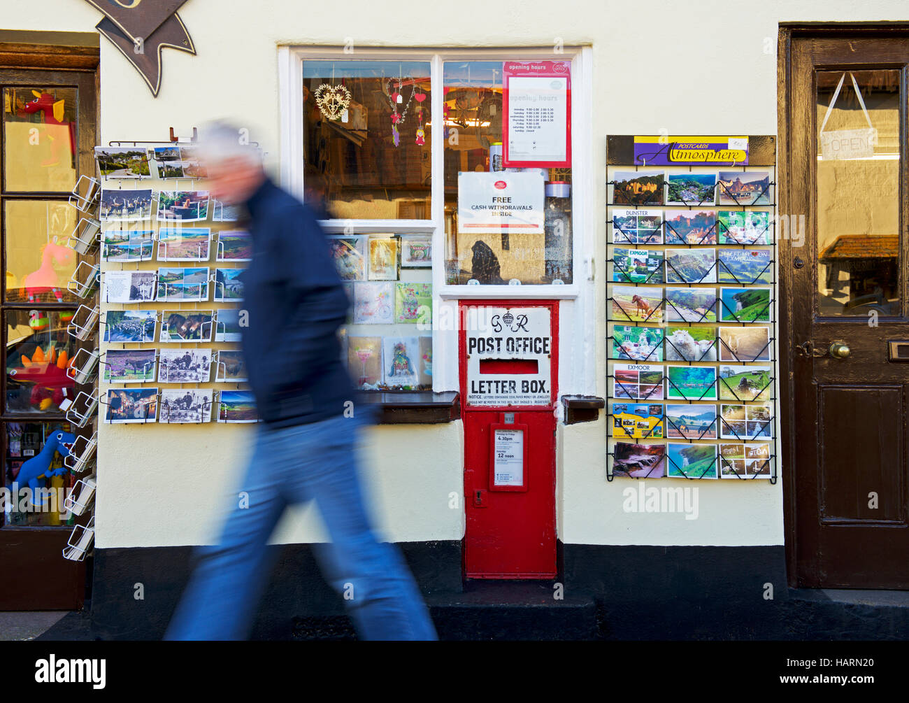 Postcards displayed outside the post office in the village of Dunster, Somerset, England UK - Stock Image