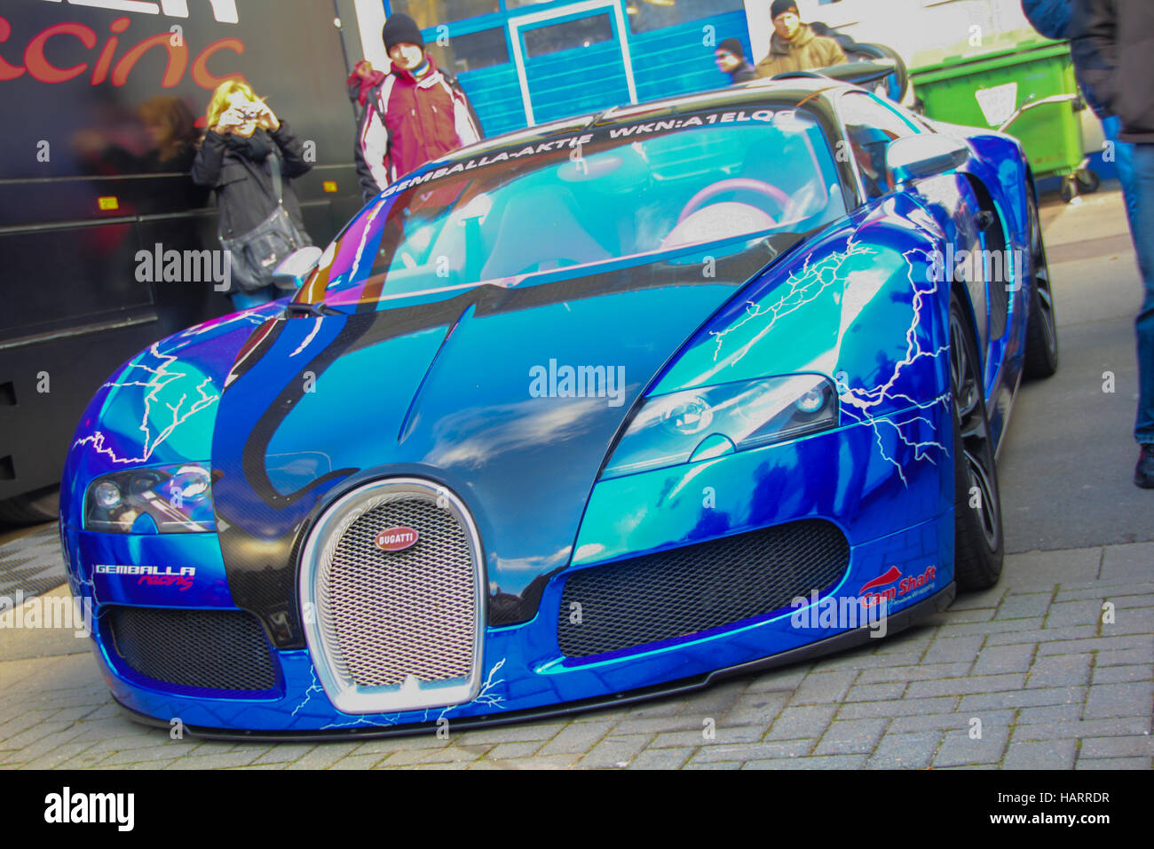541b195eaa74 Blue Bugatti Veyron 16.4 show car at motorsport event in public area with  people taking photos