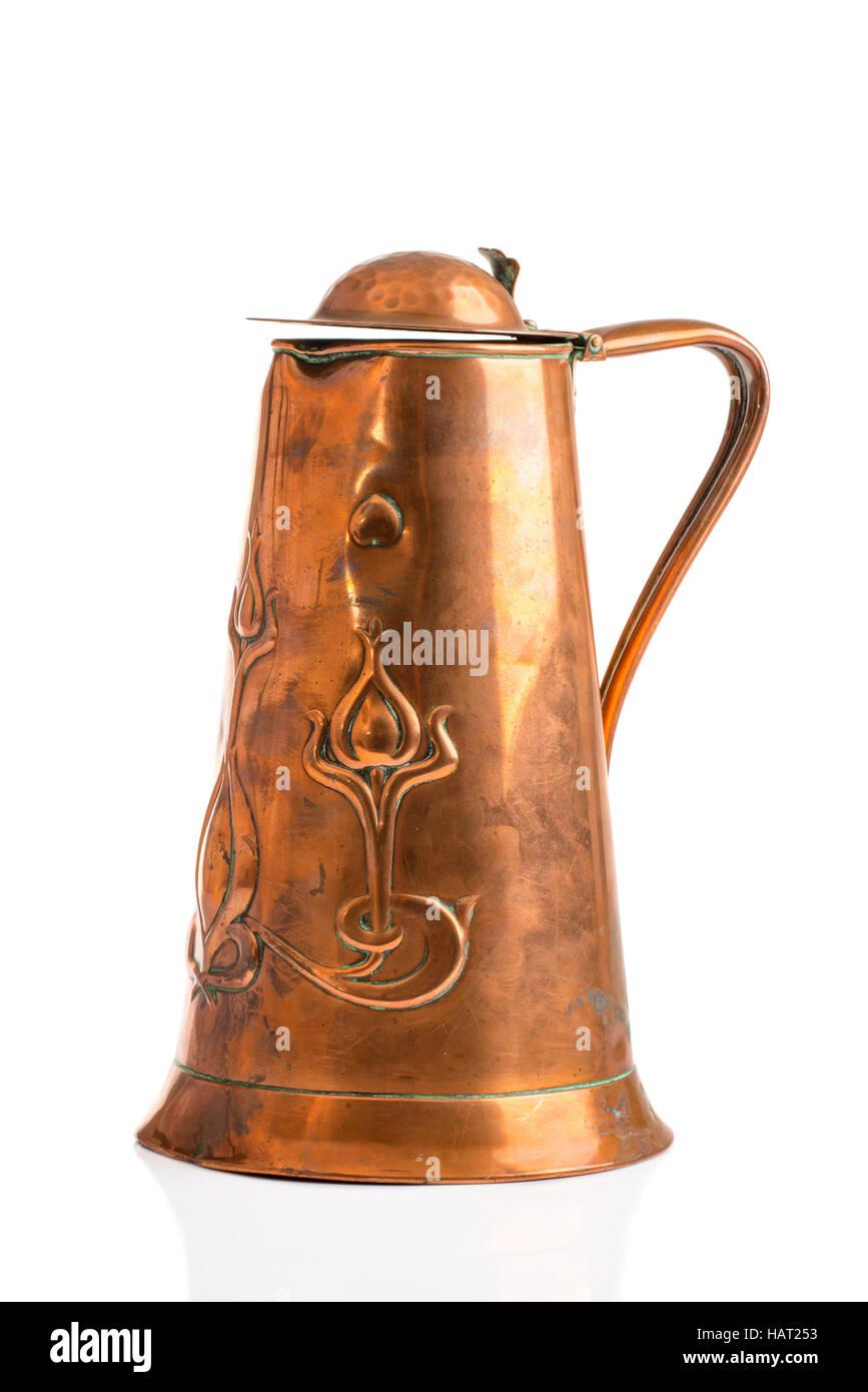 Antique Art Nouveau copper jug on a white background Stock Photo