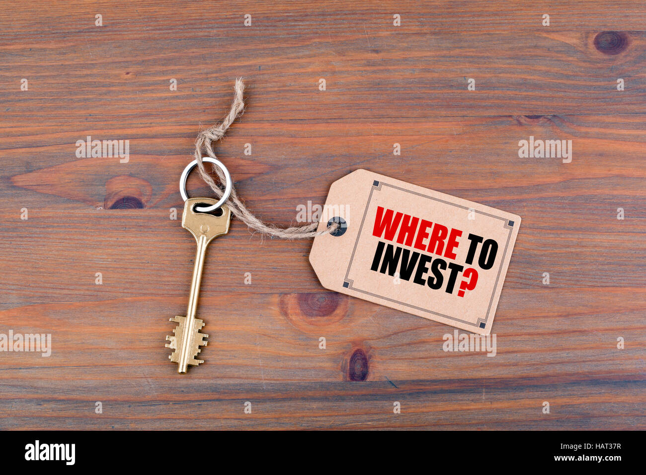 Key and a note with text - Where To Invest - Stock Image