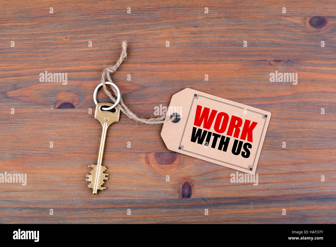 Key and a note with text - Work with us. - Stock Image