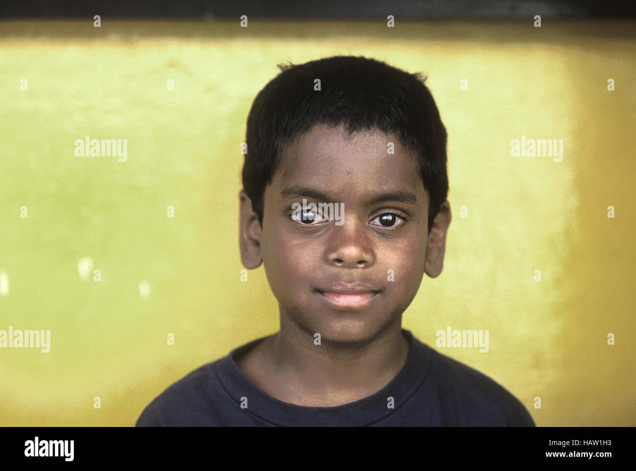 Portrait of young boy with large bright eyes. Asian Indian heritage - Stock Image