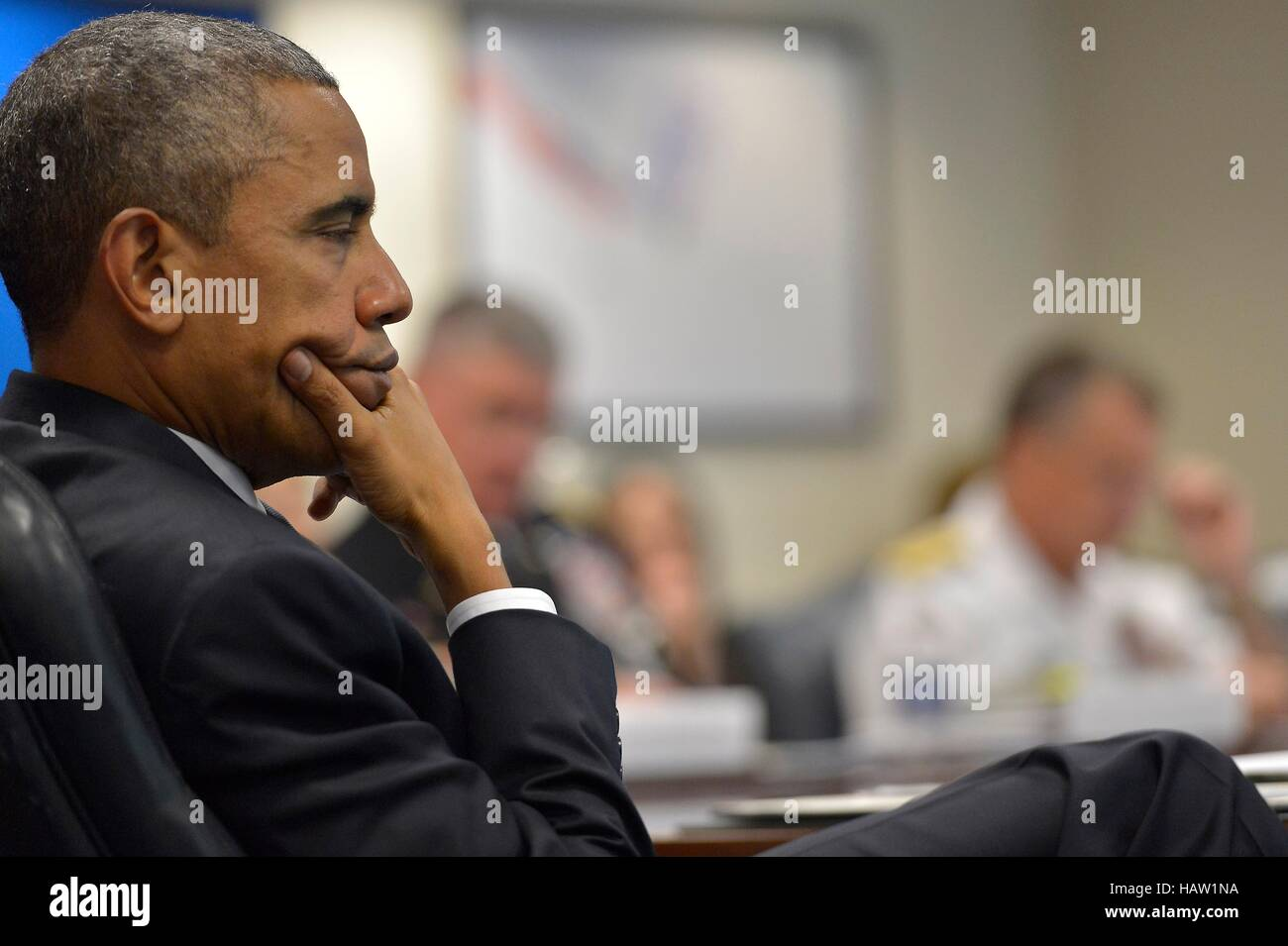 U.S. President Barack Obama listens to a national security team briefing at the Pentagon July 6, 2015 in Washington, - Stock Image