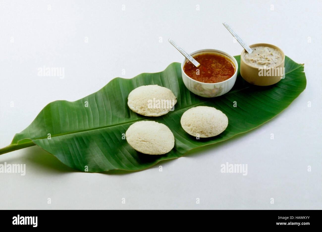 Idli Sambar, chutney on banana leaf.  South Indian snack, India Stock Photo