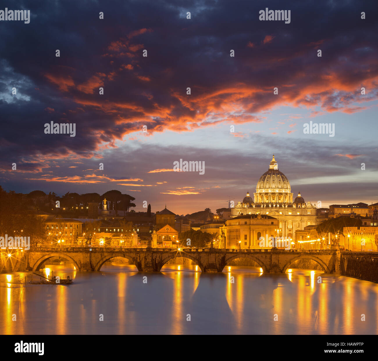 Rome - Angels bridge and St. Peters basilica in red evening dusk Stock Photo