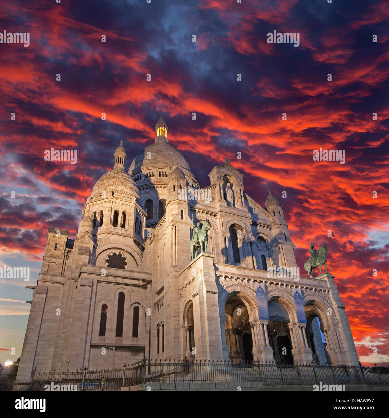 Paris - The church Sacre-couer in red evening dusk. - Stock Image