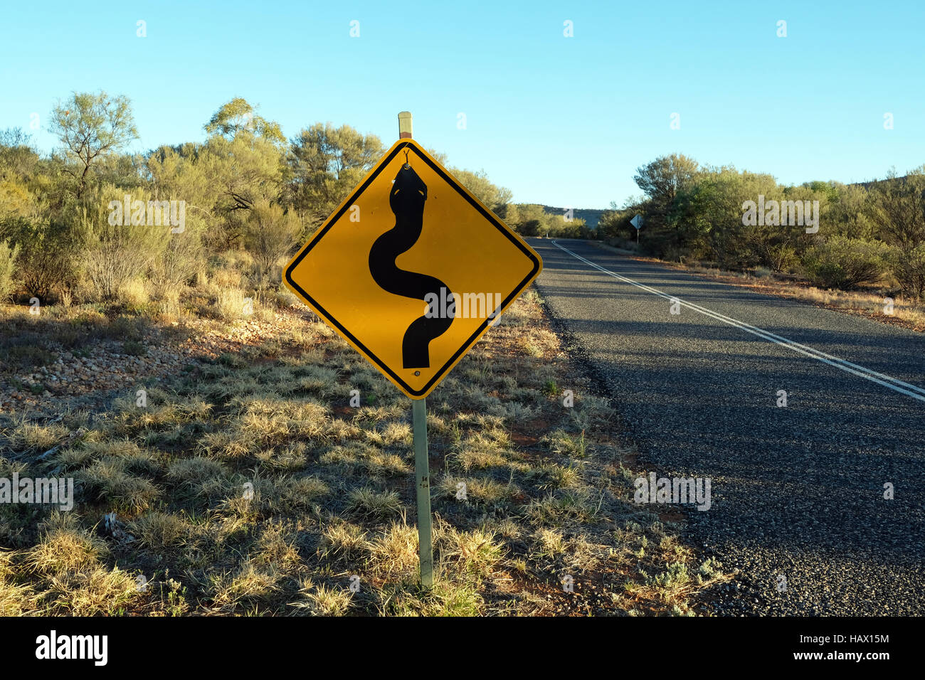 A roadside sign warning about snakes in Darken Drive, Northern Territory, Central Australia - Stock Image