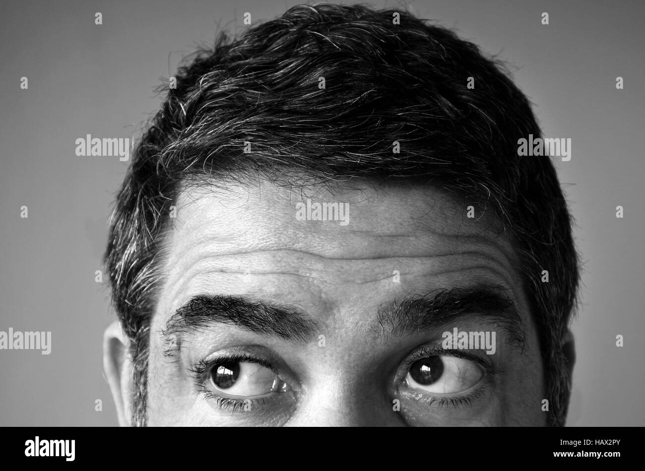 Close up of eyes of a man (age 40-45) looking for something. Man middle age concept. copy space - Stock Image