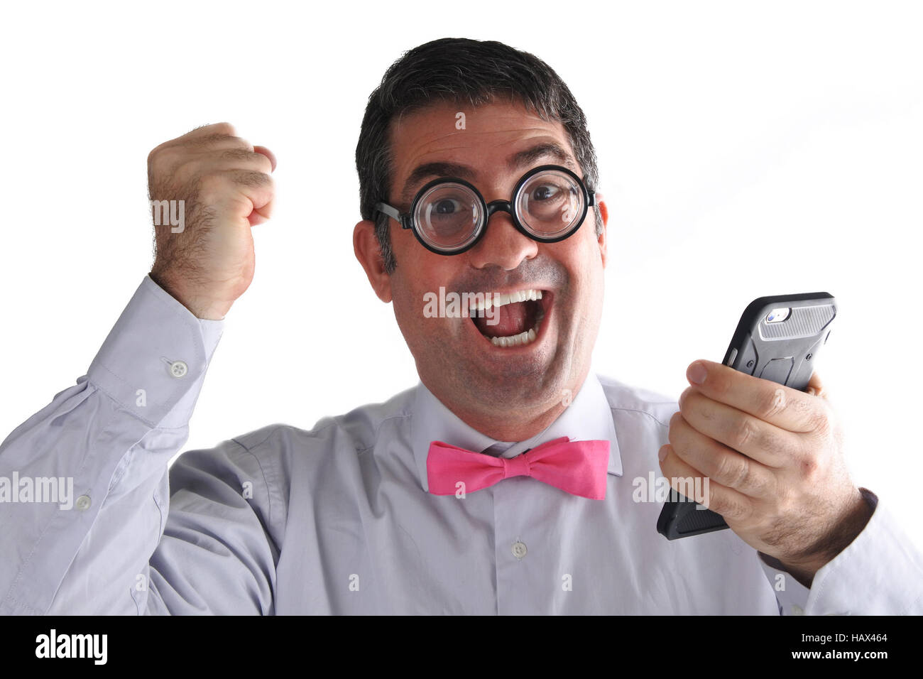 Happy Geeky man receives  an exciting message or phone call. Communication concept. Real people copy space - Stock Image