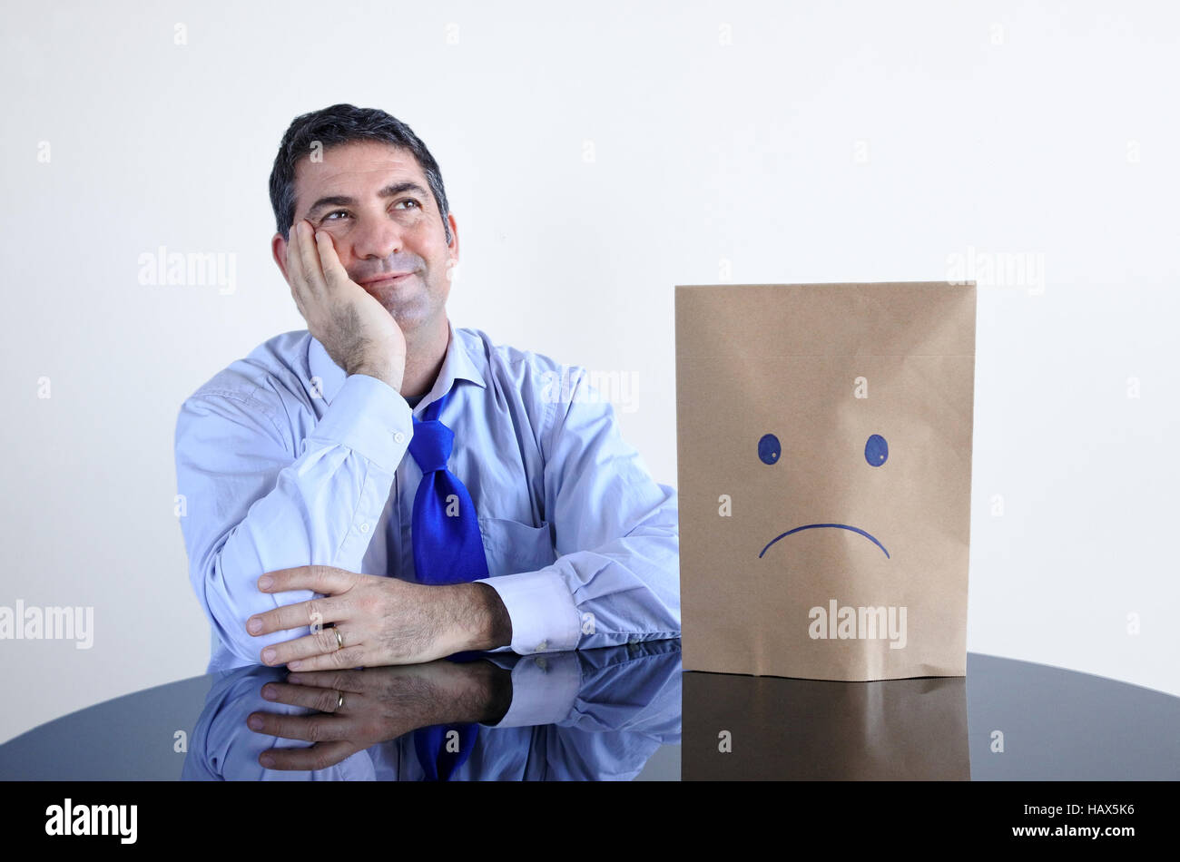 Man changing his mood from sad to happy. Real People. copy space - Stock Image