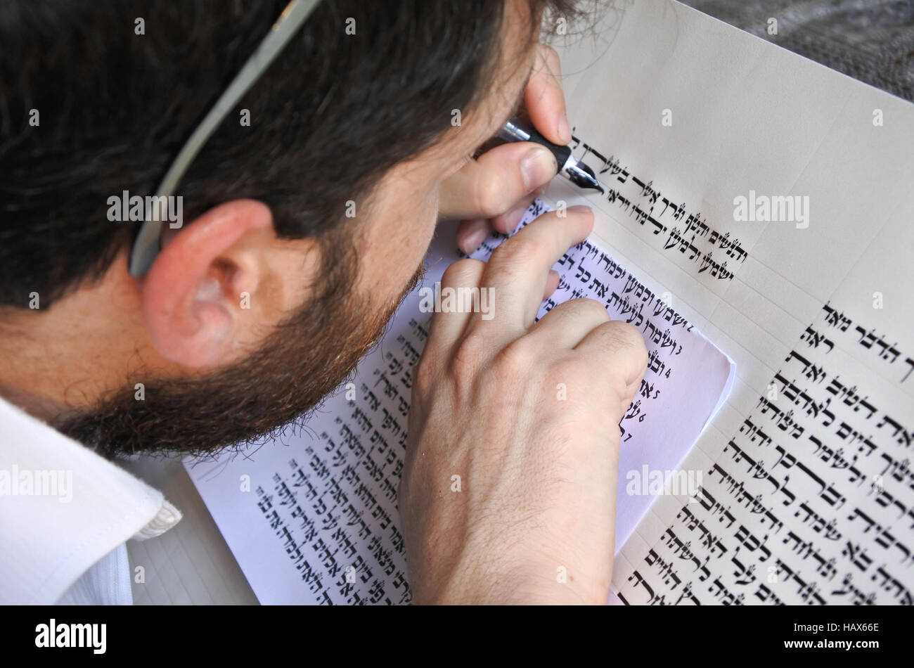 Sofer writes a sefer Torah. In the Torah's 613 commandments, the second to last is that every Jew should write - Stock Image