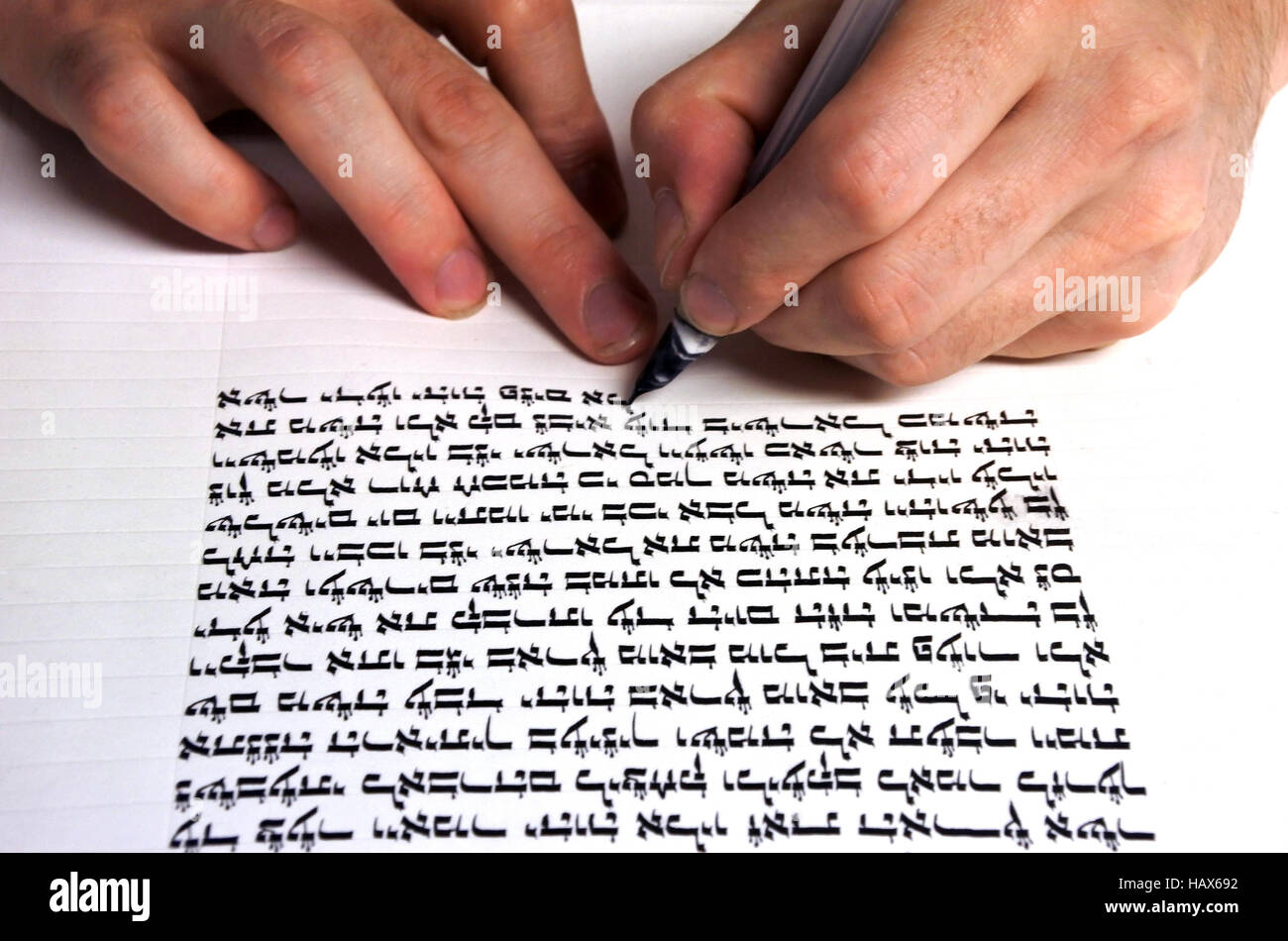 Hands of Sofer writes a sefer Torah. In the Torah's 613 commandments is every Jew should write a Sefer Torah - Stock Image
