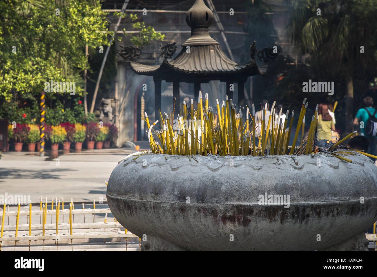 Burning incense stick - Stock Image
