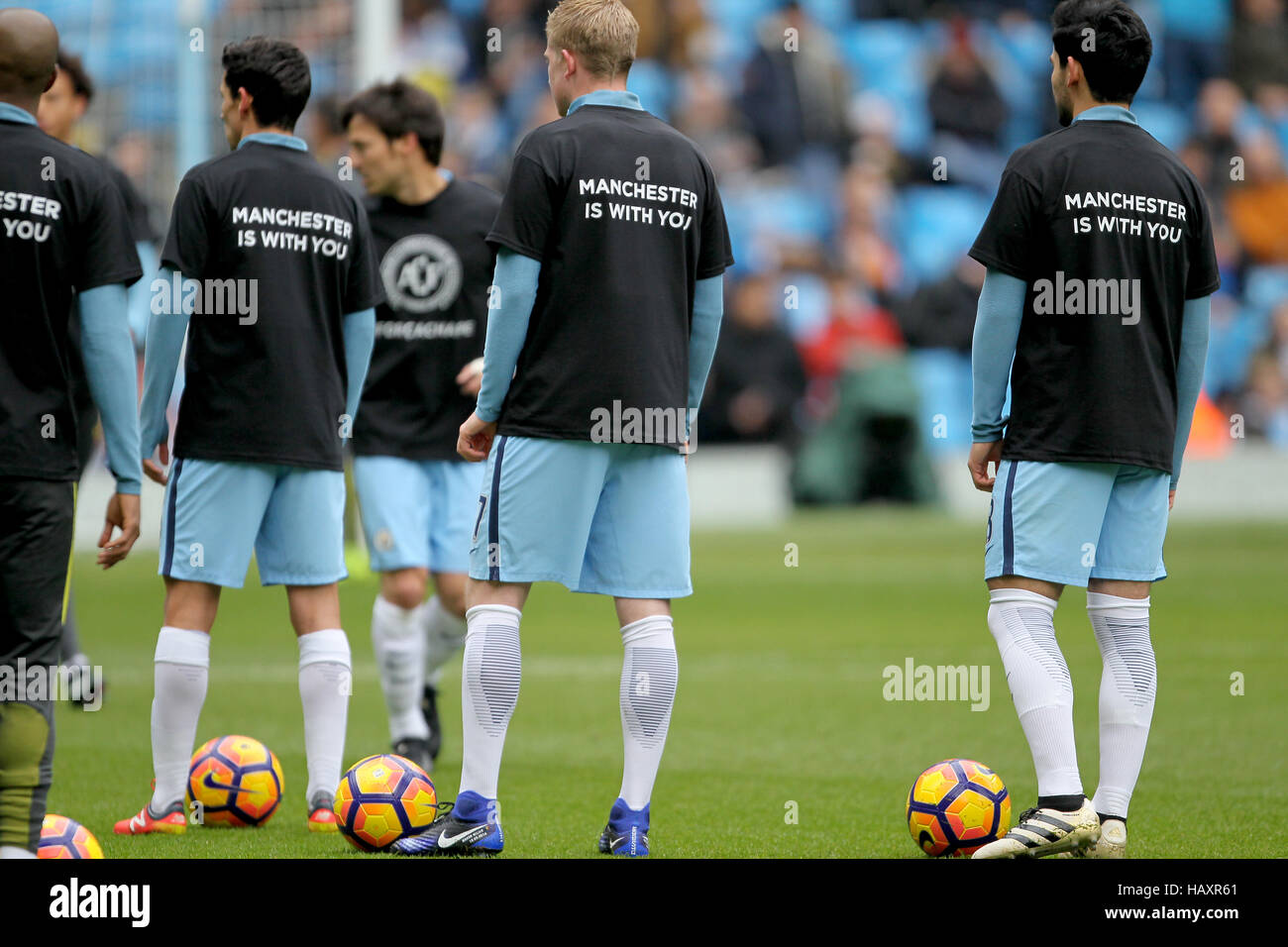 size 40 7a476 2a8dd Manchester City players warm up in warms up in t-shirts ...