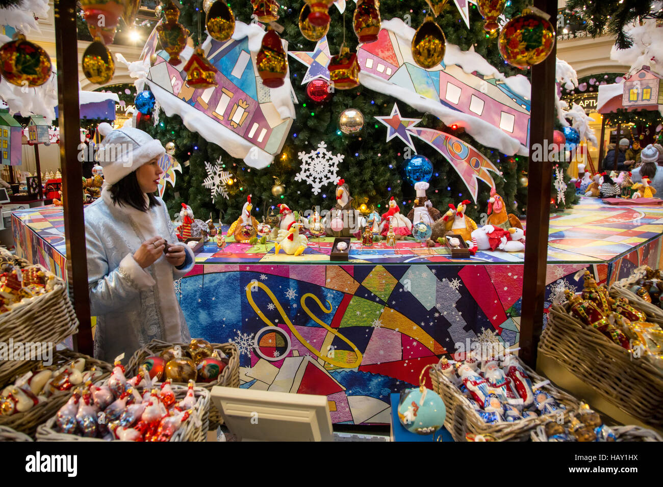 Saleswoman behind the counter at the New Year Fair in central Moscow shop GUM, Russia - Stock Image