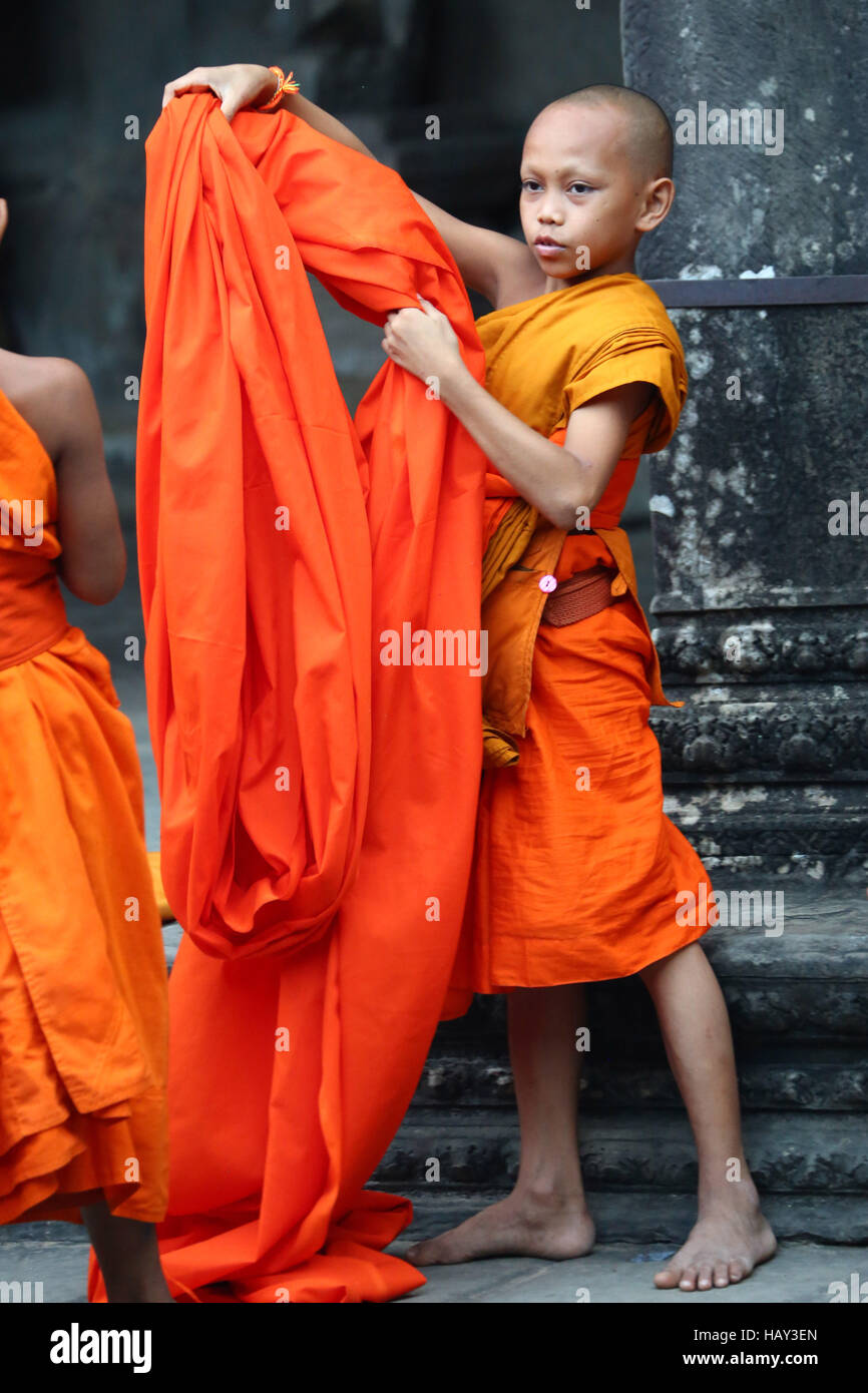Young Buddhist monk at Angkor Wat Temple in Siem Reap, Cambodia - Stock Image