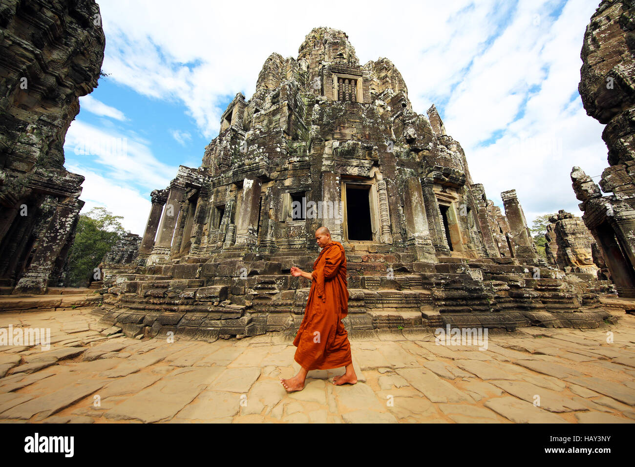 Buddhist monk in the ruins of the Bayon Khmer Temple, Angkor Thom , Siem Reap, Cambodia - Stock Image