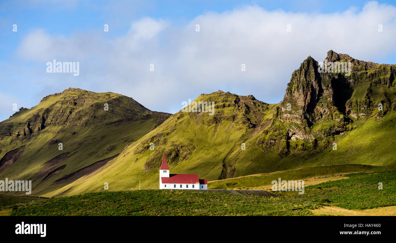 White church with a red roof on a hill in Vik, Iceland - Stock Image