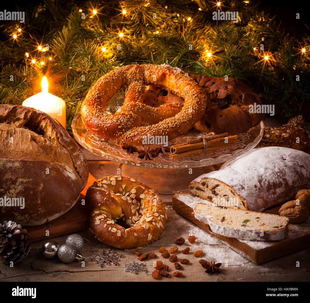 Baking for German Christmas: stollen, bretzel, bread. - Stock Image