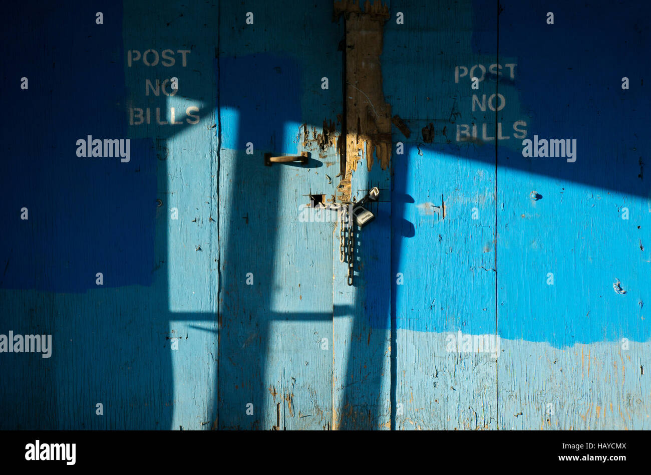 Light and shadow pattern on a cyan colored door on Northern Blvd. in Chinatown, downtown Flushing, Queens, New York. - Stock Image