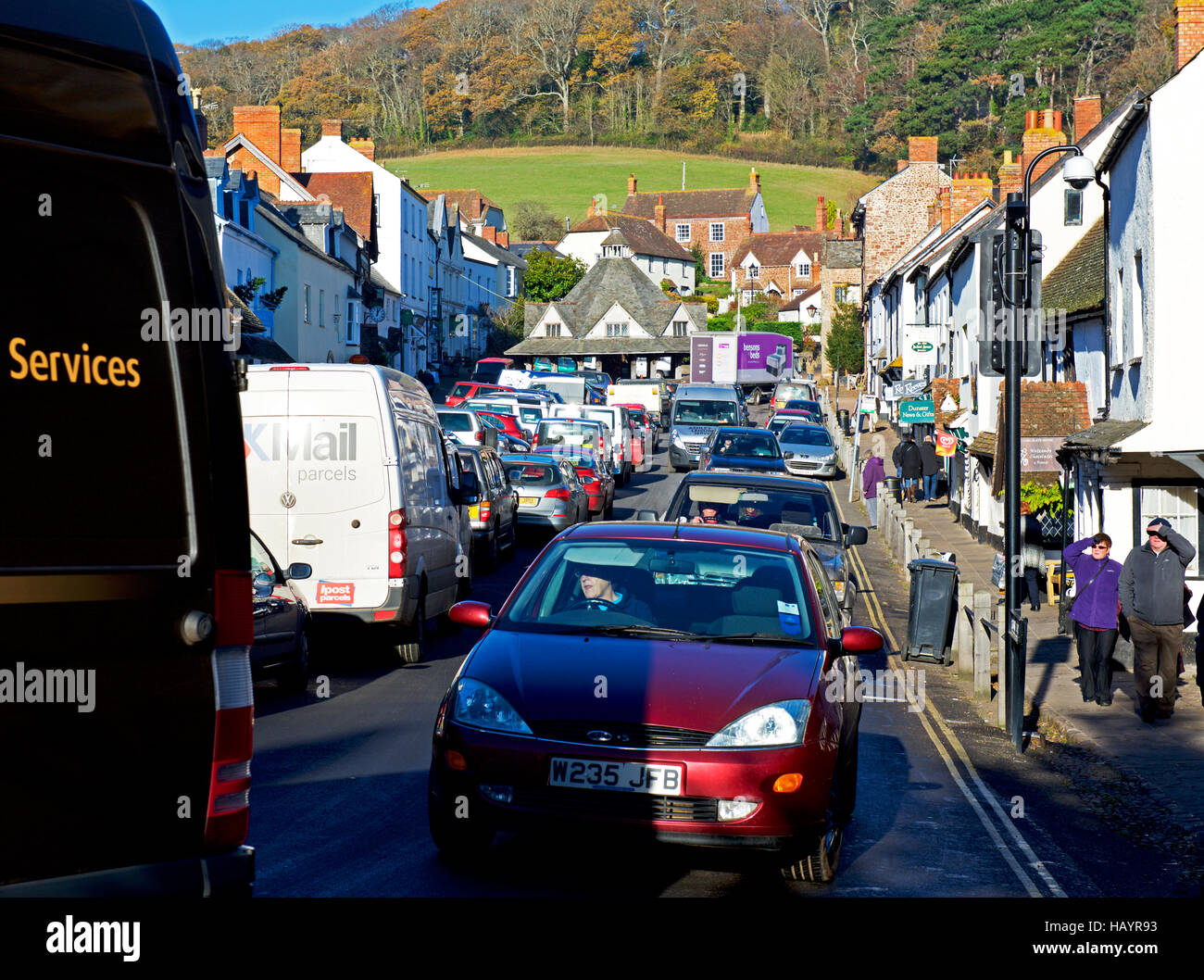 Traffic gridlock in the village of Dunster, Somerset, England UK - Stock Image