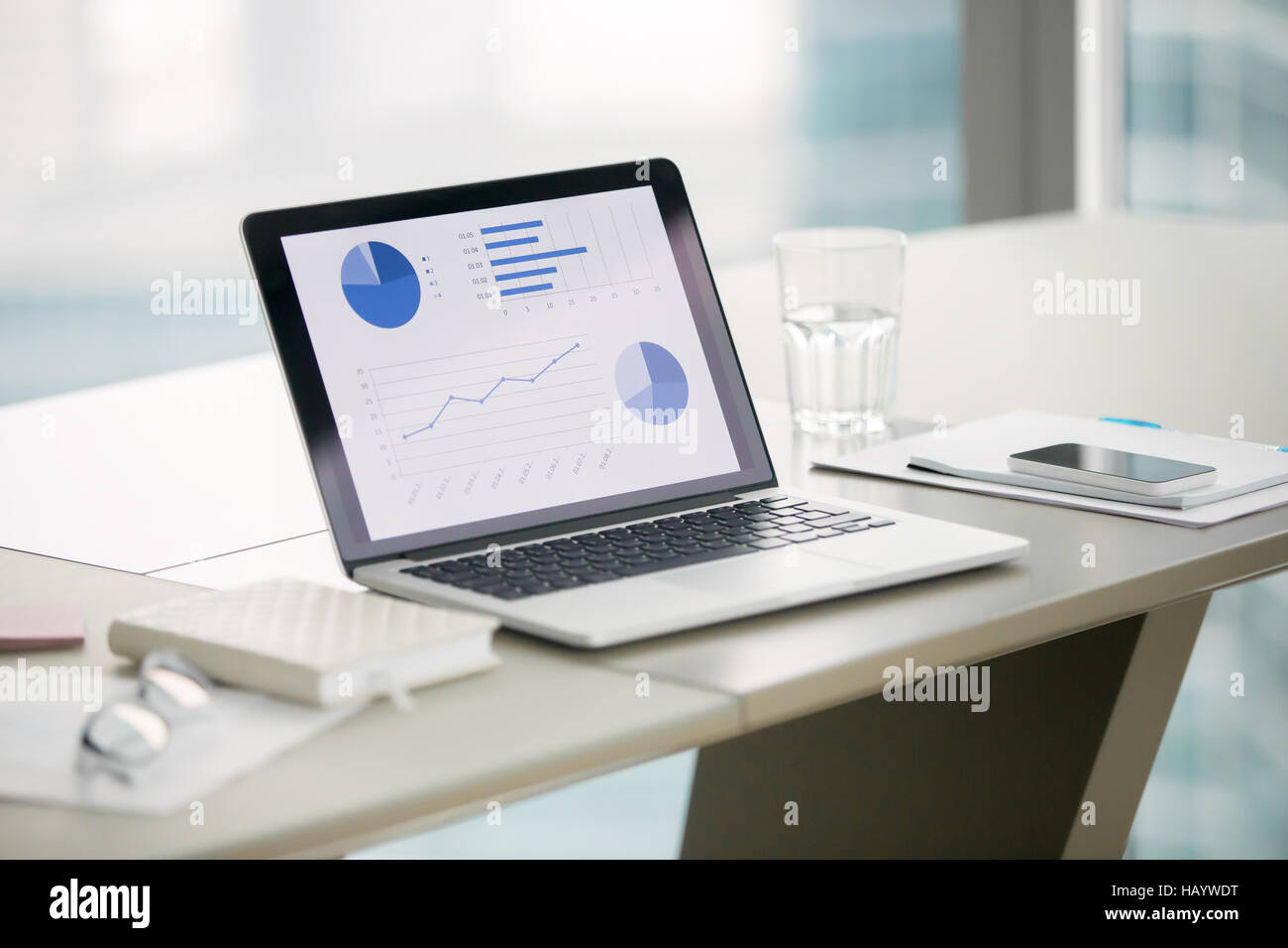 Close up of a laptop on a modern office desk - Stock Image