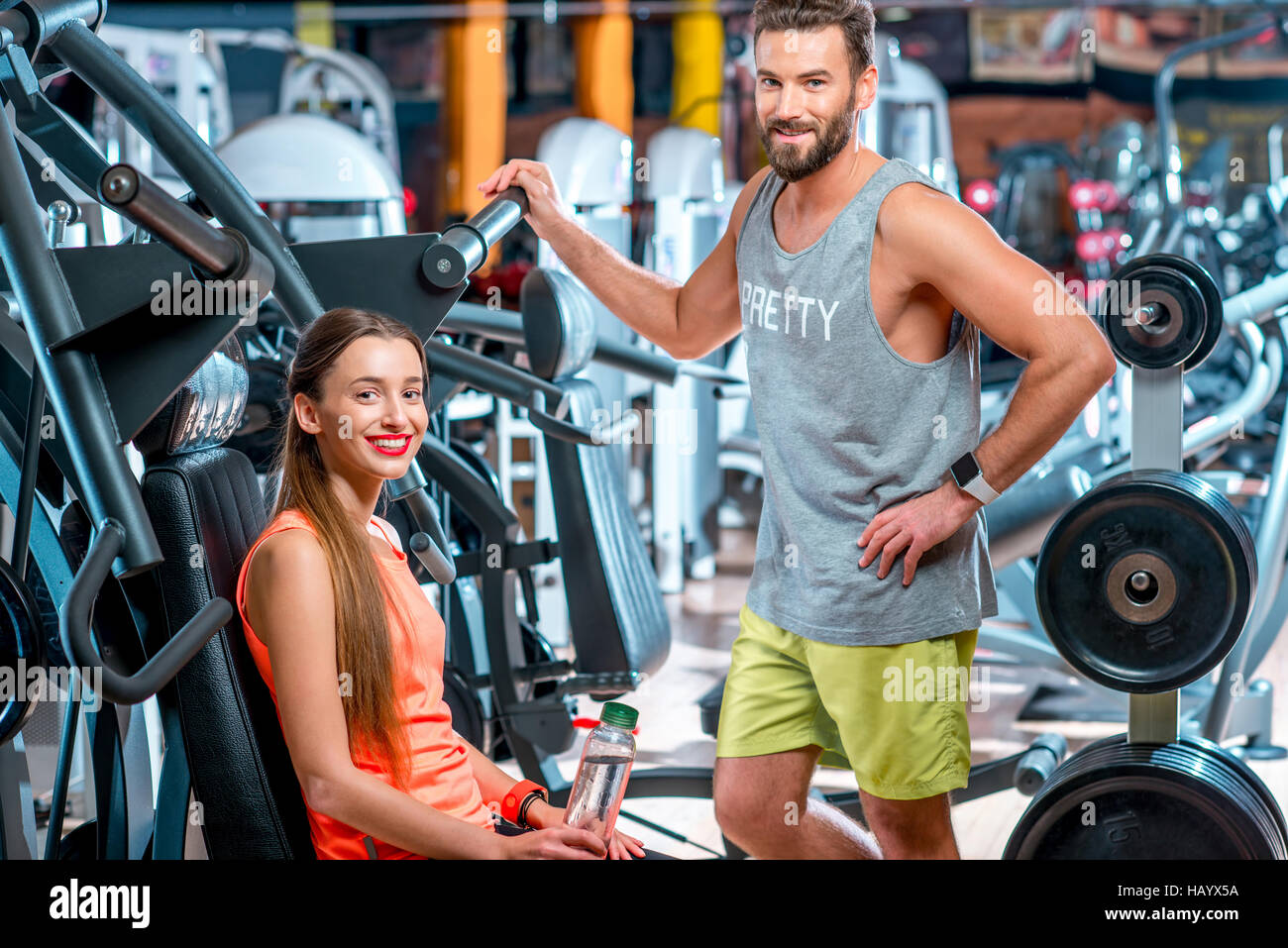 Personal trainer with woman - Stock Image
