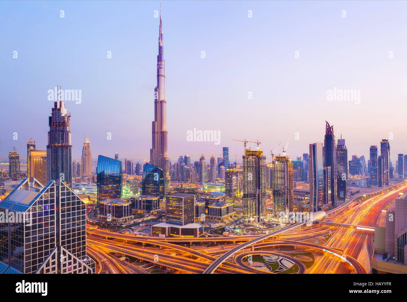 View on modern skyscrapers and busy evening highways in luxury Dubai city,Dubai,United Arab Emirates Stock Photo