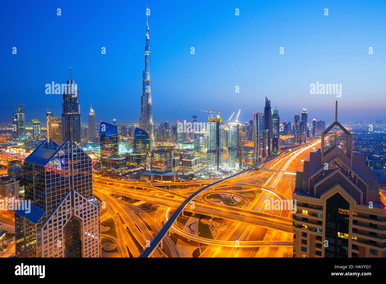 View on modern skyscrapers and busy evening highways in luxury Dubai city,Dubai,United Arab Emirates - Stock Image