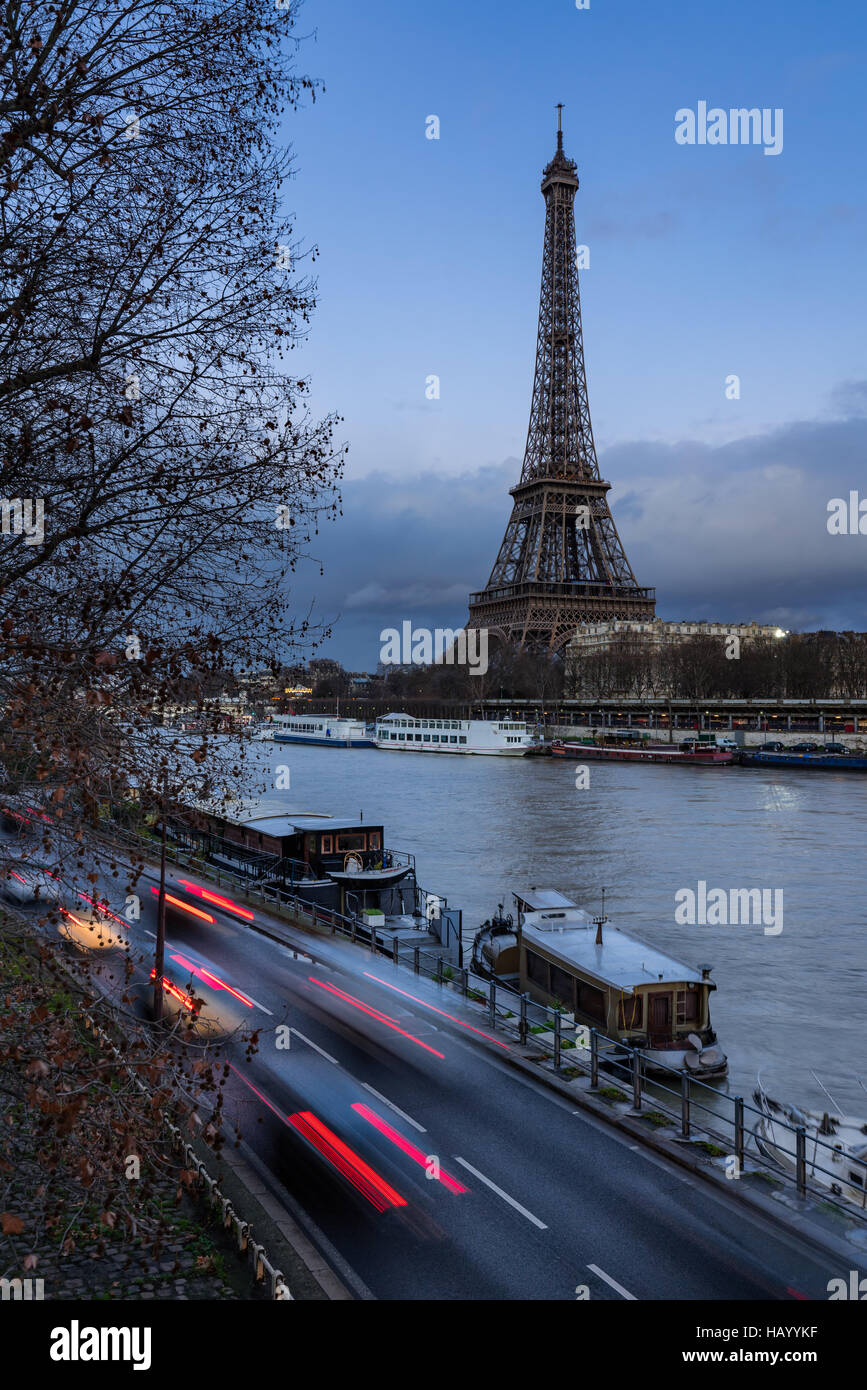 Eiffel Tower at twilight with the Seine River and car light trails. Paris, Grenelle, 7th Arrondissement, France Stock Photo