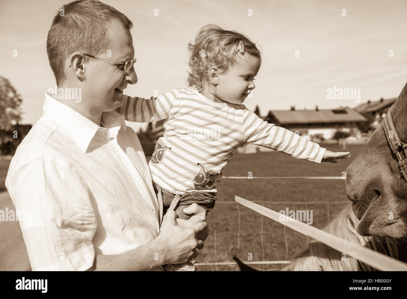 Father, Daughter, horse paddock fence, animal Stock Photo