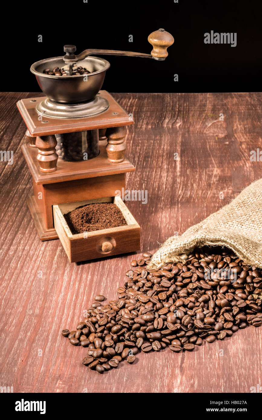 Old Coffee Grinder and Beans Stock Photo