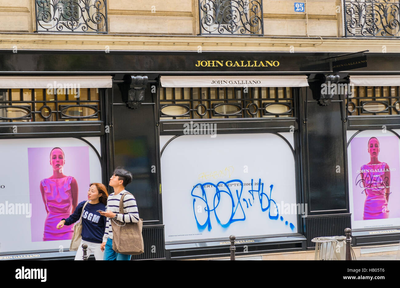 street scene in front of john galliano flagship store, marais district - Stock Image