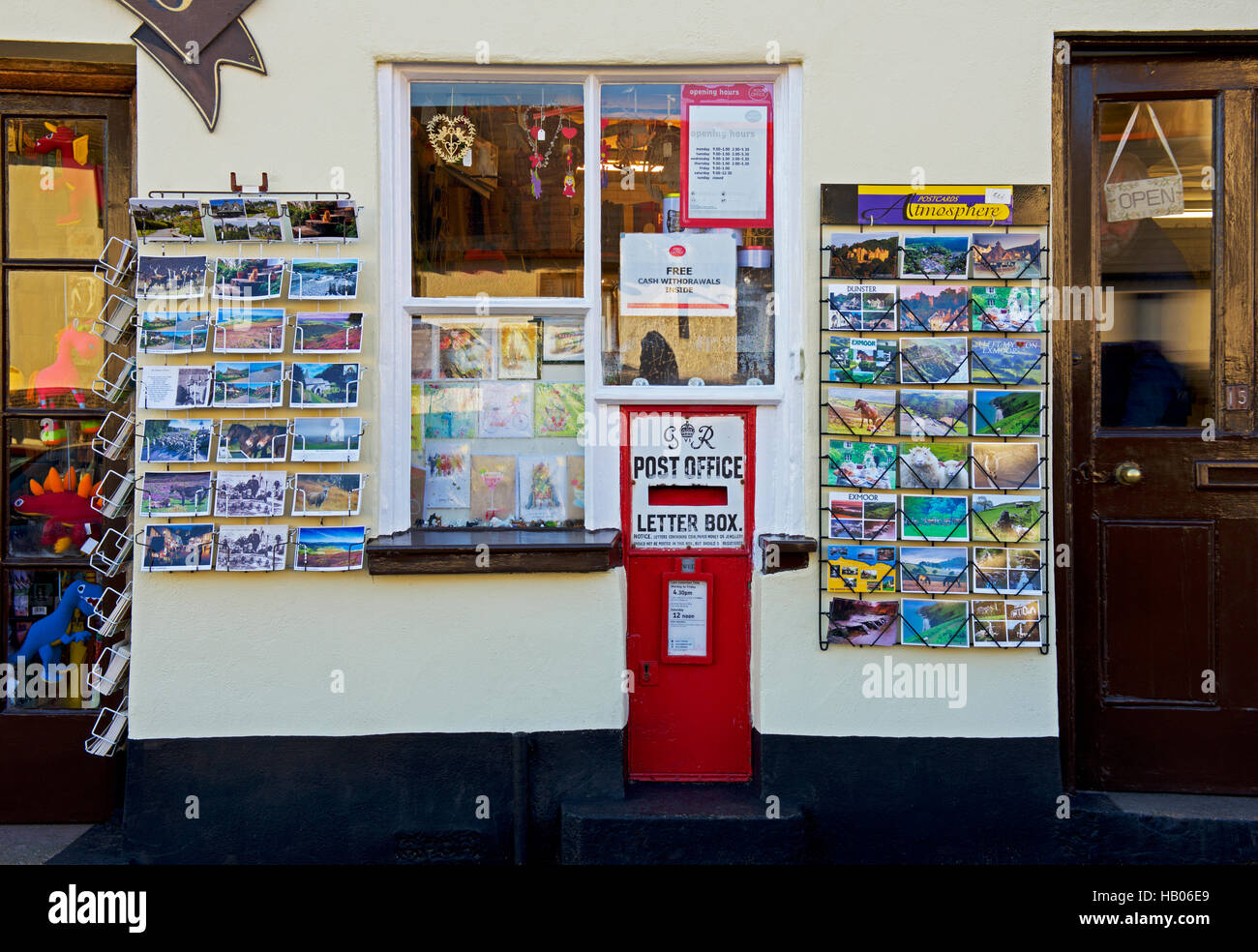 Postcards displayed outside the post office in the village of Dunster, Somerset, England UK Stock Photo