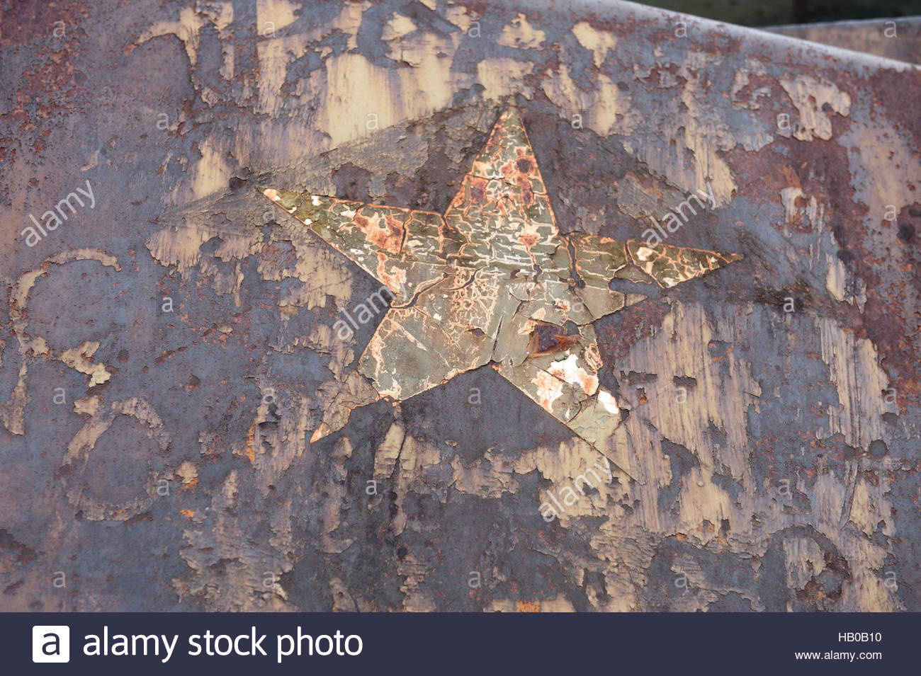 Hue Vietnam General Museum Complex. Rusting US weapons from the American War. Rusting star logo. - Stock Image