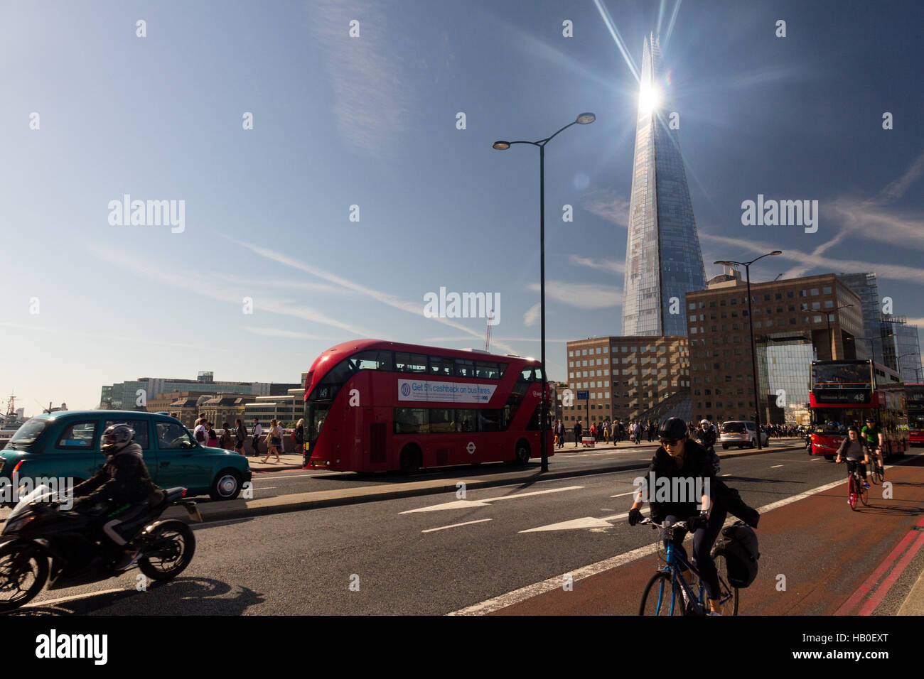 London Bridge traffic during the morning commute, with the sunlight gleaming off the Shard building in the background. Stock Photo